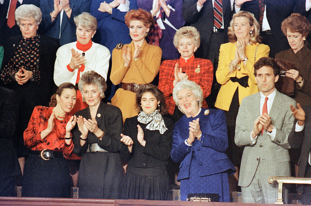 . Mrs. Barbara Bush, center, is joined by Margaret and Marvin Bush as they applaud President George H.W. Bush?s arrival to the House chamber in Washington on Jan. 31, 1990 where the president made his first State of the Union address. (AP Photo/Doug Mills)