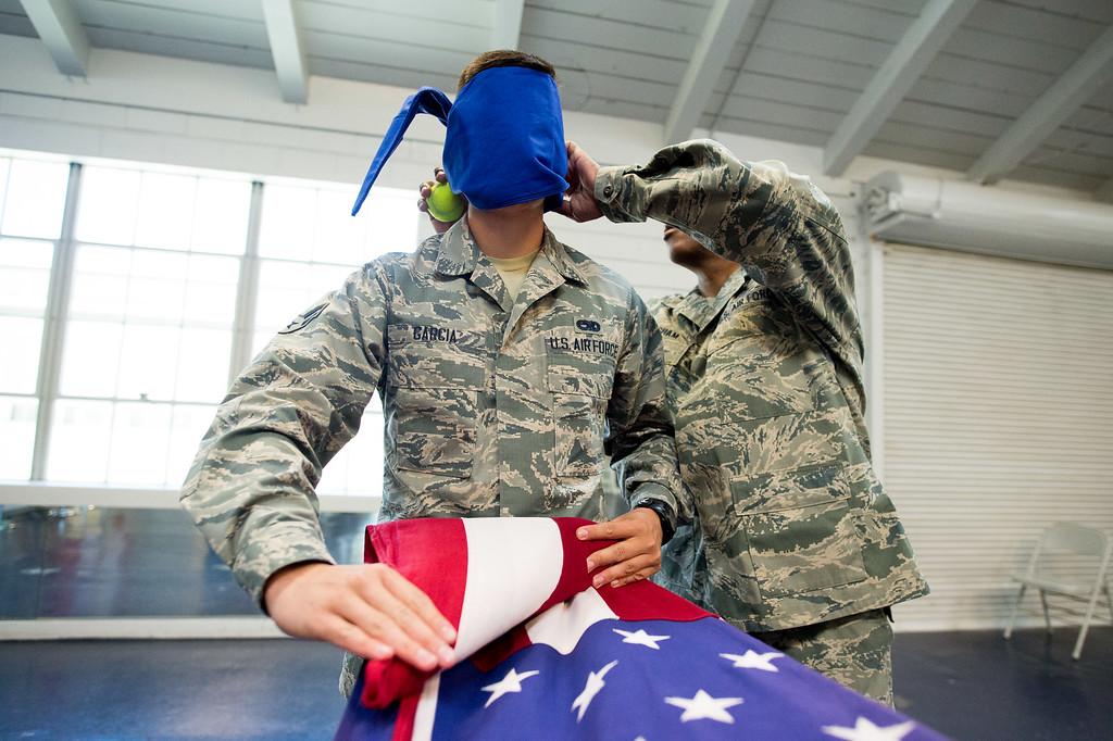 . Airman Gilbert Garcia gets blindfold by Master Sgt. Darryl Willingham during a flag folding training at March Air Reserve Base in Riverside, Calif. on Tuesday, May 12, 2015. (Photo by Watchara Phomicinda/ Los Angeles Daily News)