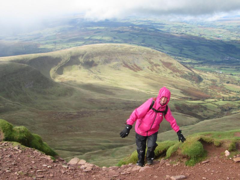 Angela reaching the summit