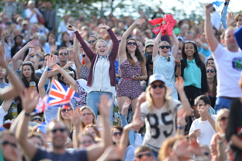 . Tennis fans cheer in front of the big screen at Murray Mount as Britain\'s Andy Murray beats Russia\'s Mikhail Youzhny in their fourth round men\'s singles match on day seven of the 2013 Wimbledon Championships tennis tournament at the All England Club in Wimbledon, southwest London, on July 1, 2013. Murray won 6-4, 7-6, 6-1.  BEN STANSALL/AFP/Getty Images