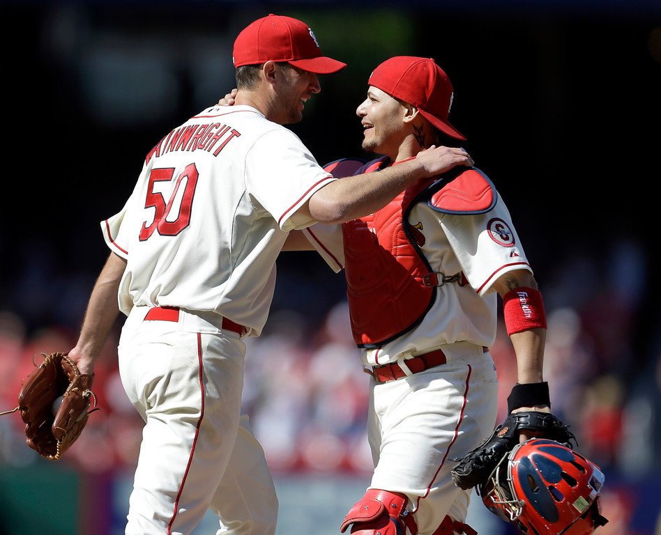 . St. Louis Cardinals starting pitcher Adam Wainwright, left, is congratulated by catcher Yadier Molina after throwing a complete baseball game against the Colorado Rockies Saturday, May 11, 2013, in St. Louis. Wainwright gave up two hits in the 3-0 victory. (AP Photo/Jeff Roberson)