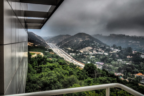 May 24 - Clouds, trees, cars, a building and a freeway.jpg