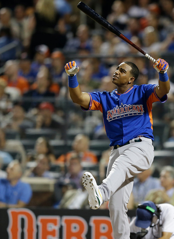 . American League\'s Yoenis Cespedes, of the Oakland Athletics, watches one of his hits during the MLB All-Star baseball Home Run Derby, on Monday, July 15, 2013 in New York. (AP Photo/Kathy Willens)