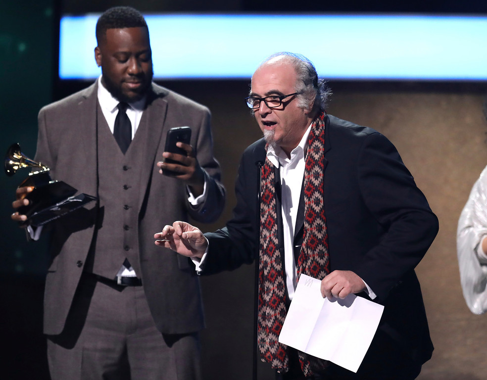 ". Robert Glasper, left, and Steve Berkowitz accept the best compilation soundtrack for visual media award for ""Miles Ahead\"" at the 59th annual Grammy Awards on Sunday, Feb. 12, 2017, in Los Angeles. (Photo by Matt Sayles/Invision/AP)"