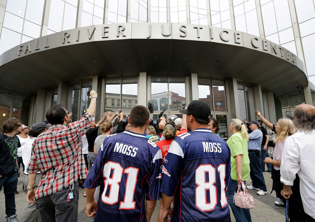 . Interested bystanders and media members crowd around the entrance to the Fall River Justice Center after a bail hearing was held for former New England Patriots football player Aaron Hernandez in Fall River Superior Court Thursday, June 27, 2013 in Fall River, Mass. Hernandez, charged with murdering Odin Lloyd, a 27-year-old semi-pro football player, was denied bail. (AP Photo/Elise Amendola)