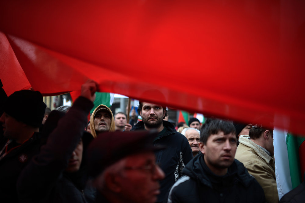 . Bulgarians attend a protest in front of the Bulgarian Parliament in Sofia on February 17, 2013. Protesters threw rocks, firecrackers, bottles, eggs and tomatoes at the police line manning the headquarters of Czech power producer CEZ and the president\'s office in protest against sky-high January electricity bills in the EU\'s poorest country, as the government drags its feet on liberalizing the energy market. DIMITAR DILKOFF/AFP/Getty Images