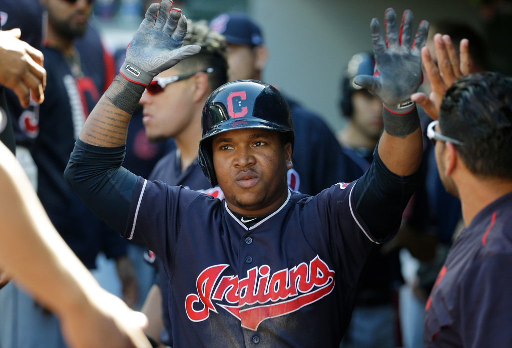 . Cleveland Indians\' Jose Ramirez is greeted in the dugout after he hit a solo home run against the Seattle Mariners in the sixth inning of a baseball game, Sunday, Sept. 24, 2017, in Seattle. (AP Photo/Ted S. Warren)