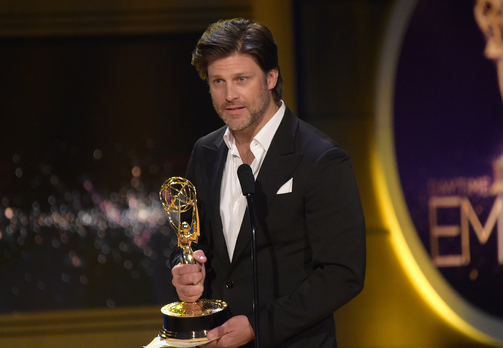 ". Greg Vaughn accepts the award for outstanding supporting actor in a drama series for ""Days of Our Lives\"" at the 45th annual Daytime Emmy Awards at the Pasadena Civic Center on Sunday, April 29, 2018, in Pasadena, Calif. (Photo by Richard Shotwell/Invision/AP)"