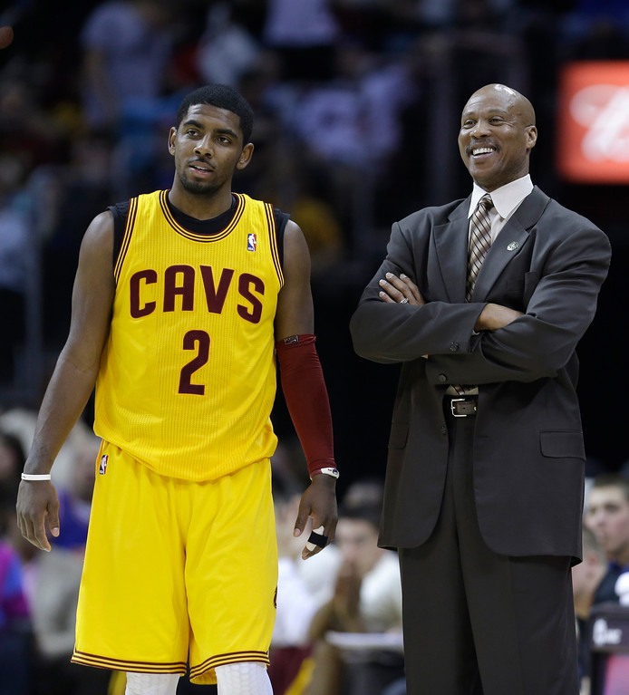 . Cleveland Cavaliers head coach Byron Scott, right, talks with guard Kyrie Irving during the fourth quarter of an NBA basketball game Sunday, April 7, 2013, in Cleveland. The Cavaliers won 91-85. (AP Photo/Tony Dejak)