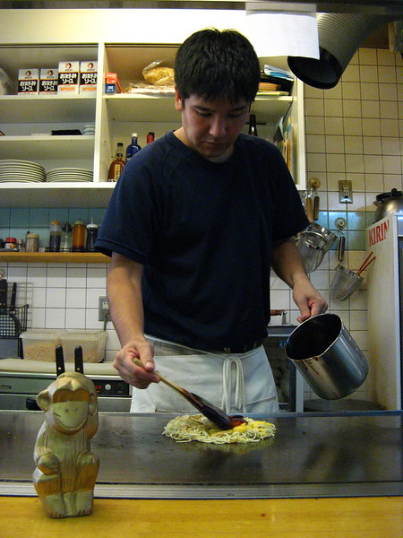 Our traveling companion 'The Golden Monkey' seeing a traditional Japanese pizza (Okanamiaki) being made