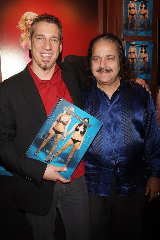 ". Photographer Michael Grecco (L) and adult film star Ron Jeremy attend a party to celebrate Grecco\'s new book ""Naked Ambition\"" at Rizzoli Book Store on November 27, 2007 in New York City.  (Photo by Scott Gries/Getty Images)"