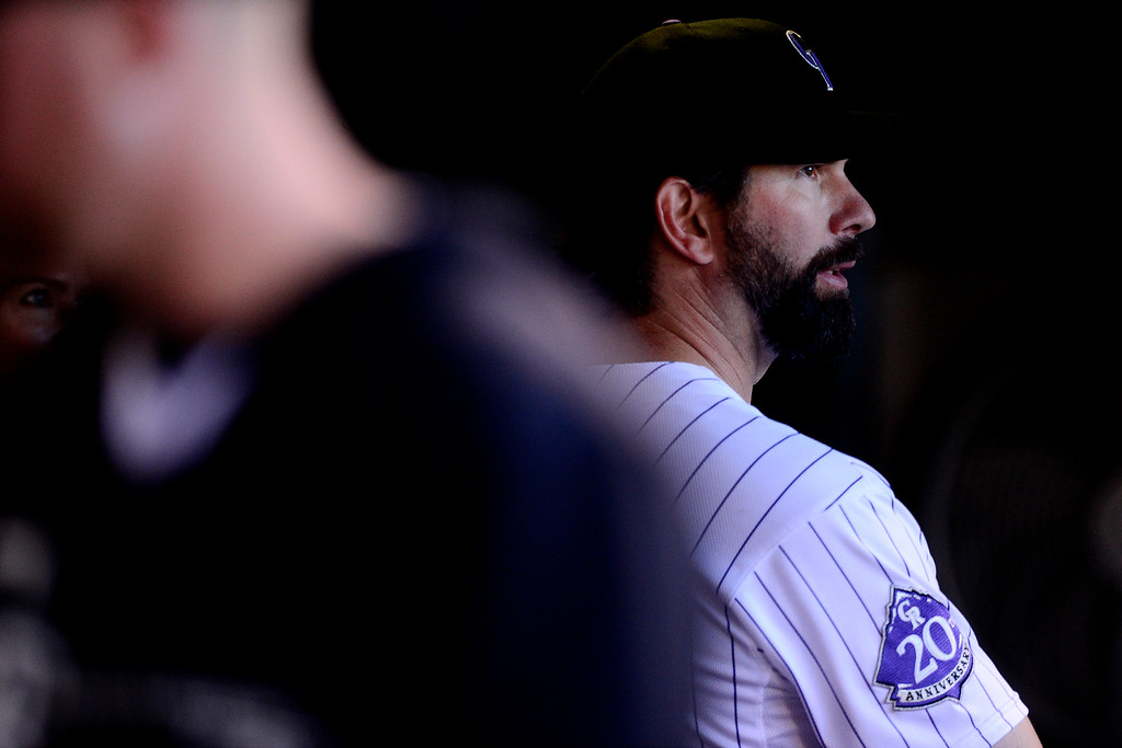 . Todd Helton stands in the dugout before the start of action in Denver. The Colorado Rockies hosted the Boston Red Sox and said farewell to longtime first baseman Todd Helton, who recently announced his retirement following this season. (Photo by AAron Ontiveroz/The Denver Post)