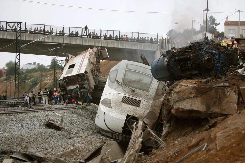 . Emergency personnel respond to the scene of a train derailment in Santiago de Compostela, Spain, on Wednesday, July 24, 2013. (AP Photo/ El correo Gallego/Antonio Hernandez)