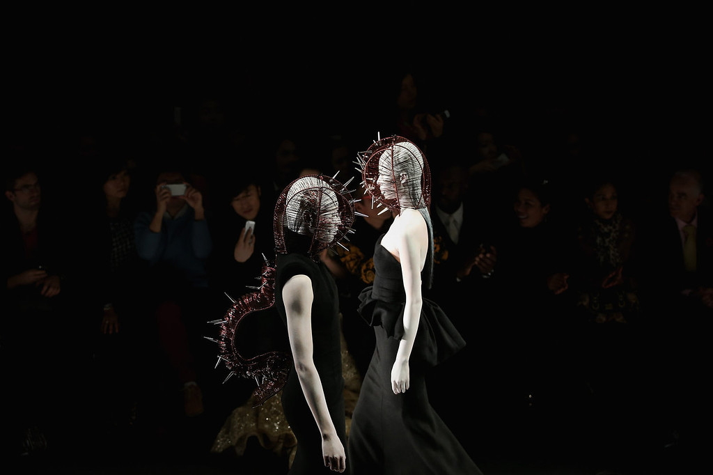 . Two models showcase designs on the runway at Hu Sheguang Haute Couture Collection show during Mercedes-Benz China Fashion Week Spring/Summer 2014 at 751 D-PARK Workshop on October 29, 2013 in Beijing, China.  (Photo by Feng Li/Getty Images)