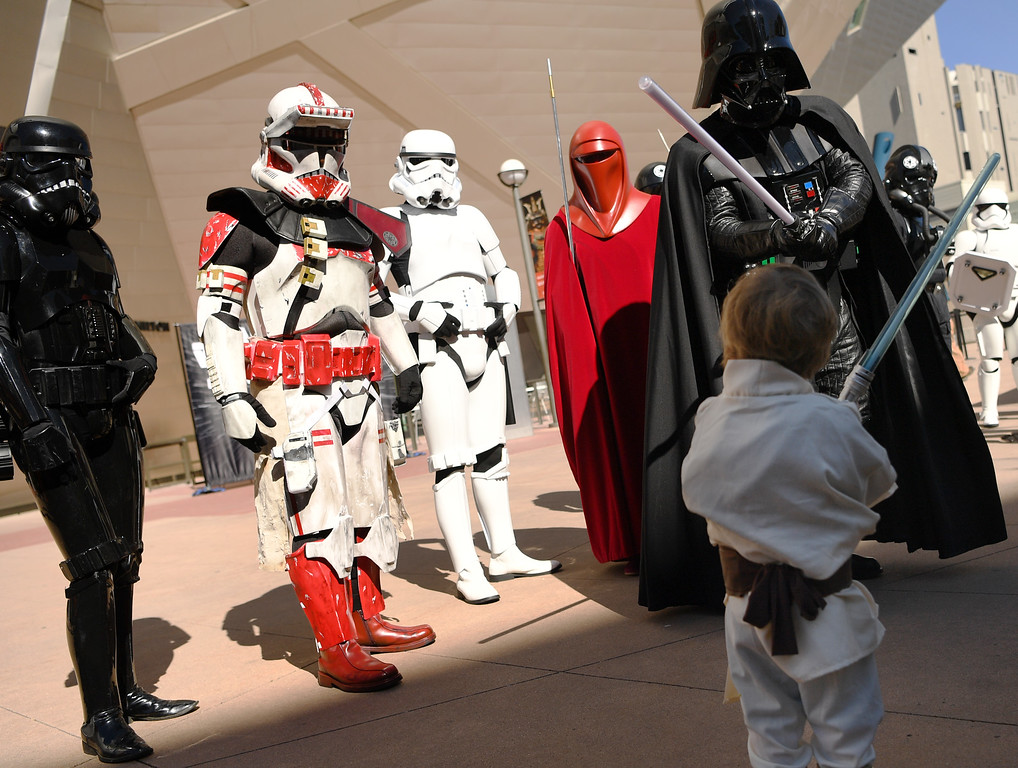 . Jude Lev, 3, takes on Darth Vader in a battle outside the Denver Art Museum, May 04, 2016.  (Photo by RJ Sangosti/The Denver Post)