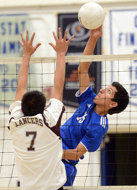 . El Rancho\'s Bryan Rojas (#15) tips the ball over as they play Bell Gardens in their non-league game at El Rancho High School in Pico Rivera on Friday March 28, 2014. Bell Gardens defeated El Rancho 3-2 games. (Staff Photo by Keith Durflinger/Whittier Daily News)