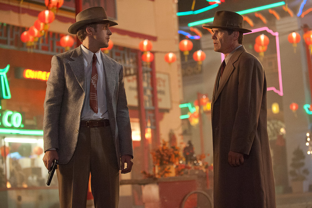 """. This film image released by Warner Bros. Pictures shows  Ryan Gosling, left, as Sgt. Jerry Wooters, and Josh Brolin, as Sgt. John O\'Mara in \""""Gangster Squad.\"""" (AP Photo/Warner Bros. Pictures, Jamie Trueblood)"""