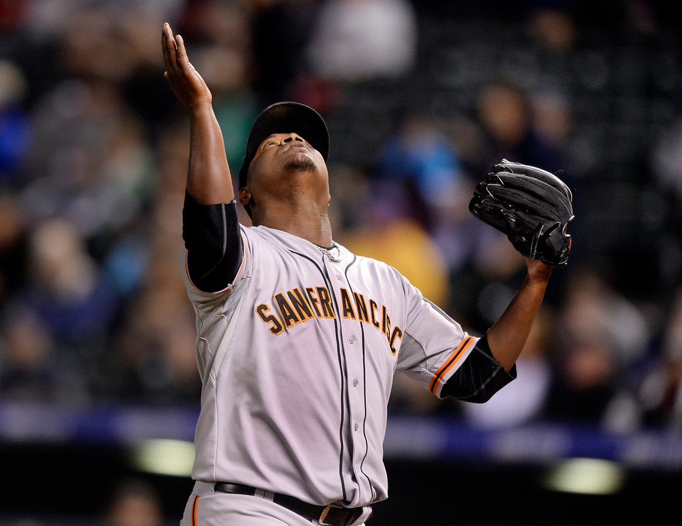 . Giants reliever Juan Gutierrez gestured skyward after the pitched a scoreless seventh inning. The Colorado Rockies hosted the San Francisco Giants Wednesday night, May 21, 2014.  (Photo by Karl Gehring/The Denver Post)