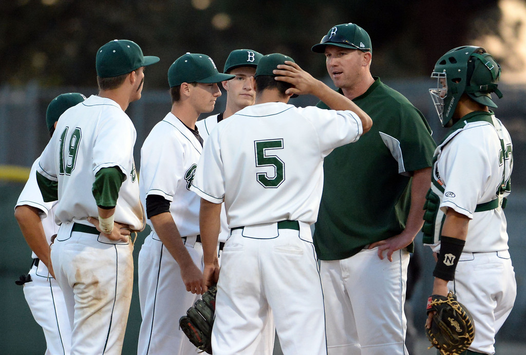 . Bonita head coach John Knott talks to his team in the second inning of a prep baseball game against San Dimas at Bonita High School in La Verne, Calif., on Wednesday, March 19, 2014.  (Keith Birmingham Pasadena Star-News)
