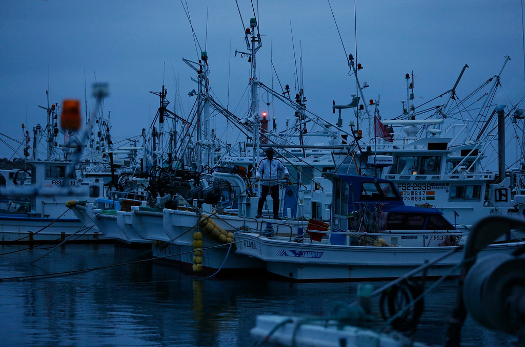 . A fisherman stands on his boat in Hisanohama port in Iwaki, about 30 km (19 miles) south of the Fukushima Daiichi nuclear power plant, Fukushima prefecture May 26, 2013. Commercial fishing has been banned near the tsunami-crippled nuclear complex since the March 2011 tsunami and earthquake. The only fishing that still takes place is for contamination research, and is carried out by small-scale fishermen contracted by the government.  Picture taken May 26, 2013. REUTERS/Issei Kato