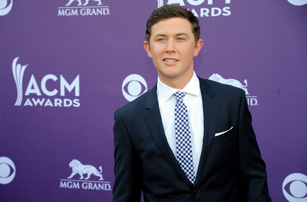 . Musician Scotty McCreery arrives at the 48th Annual Academy of Country Music Awards at the MGM Grand Garden Arena in Las Vegas on Sunday, April 7, 2013. (Photo by Al Powers/Invision/AP)