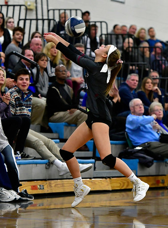 11/8/2018 Mike Orazzi | Staff Farmington High School's Olivia Klinzmann (4) during the Class L Second Round State Girls Volleyball Tournament in Bristol Thursday night.