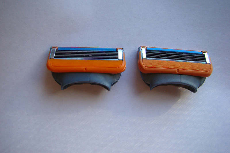 Real: Left Fake: Right Notice: Dimple on Orange Rubber Strip is more of a 'slot' on Fake