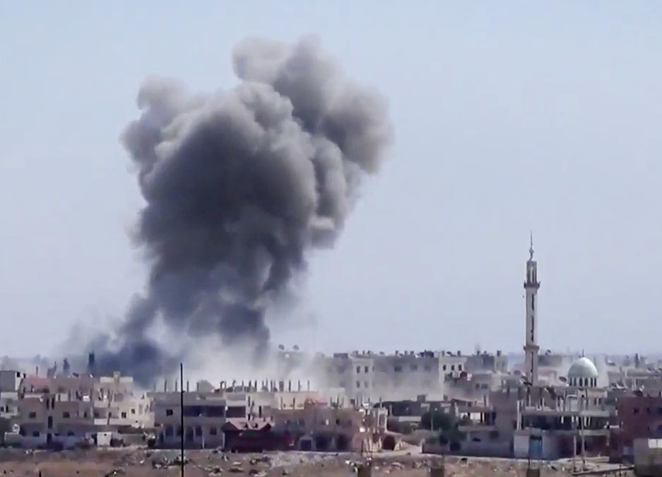 . In this Tuesday, Aug. 27, 2013 image taken from video obtained from the Ugarit News, which has been authenticated based on its contents and other AP reporting, smoke rises from buildings due to heavy shelling in Daraa, Syria, Wednesday, Aug. 28, 2013. (AP Photo/Ugarit News via AP video)