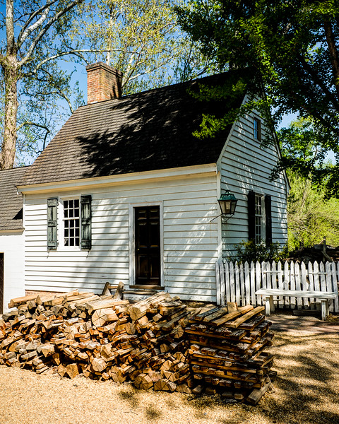 Colonial Cottage with Split Firewood Pile