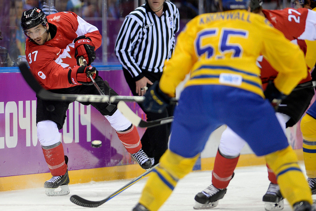 . Patrice Bergeron (37) of Canada takes a shot against Sweden during the first period of the men\'s ice hockey gold medal game. Sochi 2014 Winter Olympics on Sunday, February 23, 2014 at Bolshoy Ice Arena. (Photo by AAron Ontiveroz/ The Denver Post)