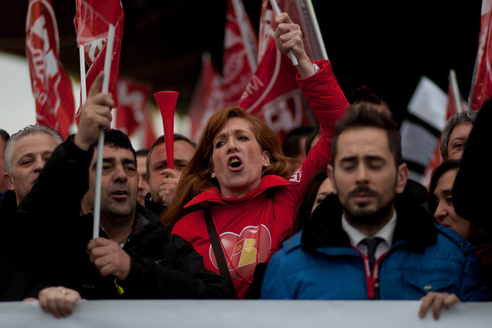 . Staff from Spanish Airline Iberia hold flags and gather in protest against job cuts at Barajas Airport on February 18, 2013 in Madrid, Spain. Today is the first of a five day strike held by Iberia cabin crew, maintenance workers and ground staff in response to the planned loss of 3,800 jobs. The strike has resulted in the airline having to cancel 400 flights this week with unions planning a further five day strikes within a month.  (Photo by Pablo Blazquez Dominguez/Getty Images)