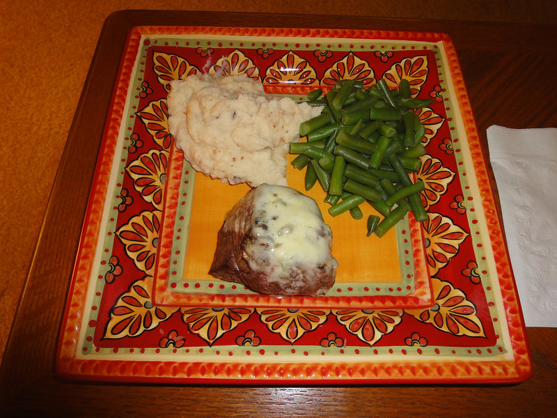 Filet mignon with gorganzola cheese, garlic mashed potatoes and green beans.
