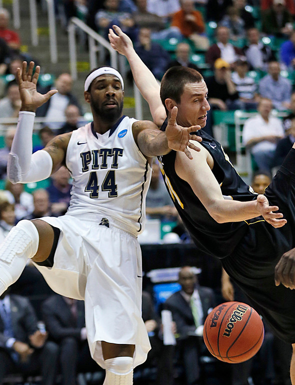 . Wichita State Jake White, right, and Pittsburgh\'s J.J. Moore fight for a rebound during a second-round game in the NCAA college basketball tournament in Salt Lake City, Thursday, March 21, 2013. (AP Photo/George Frey)