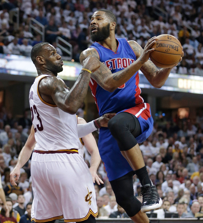 . Detroit Pistons\' Marcus Morris, right, drives past Cleveland Cavaliers\' LeBron James in the second half in Game 2 of a first-round NBA basketball playoff series, Wednesday, April 20, 2016, in Cleveland. The Cavaliers won 107-90. (AP Photo/Tony Dejak)