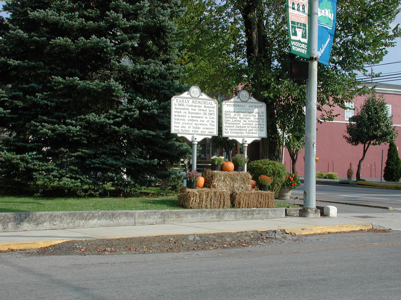 Here are signs outside the Romney Courthouse. Romney is an old area and originally a Fort.