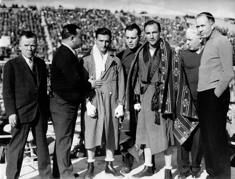 . San Francisco, CA February 22, 1933 - Jackie Fields and Young Corbett III met for a bout at the Seals Stadium. From left: Terry Murnane, manager Ralph Manfredo, Young Corbett III, trainer Joey Greenberg, Jackie Fields, Dolph Thomas and manager Jack Kearns. (Oakland Tribune Photo)