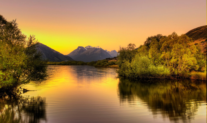 Glenorchy pond at sunset.   This is one of the locations used in the Lord of the Rings films.  The Frodo and Sam's trek through swamps and Boromir's death, are the two scene's that I know were filmed here.