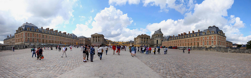 Palace at Versailles, front plaza. This is a panorama of three stitched photos. The entire grounds of the Palace are about 300 times larger than everything you see here.