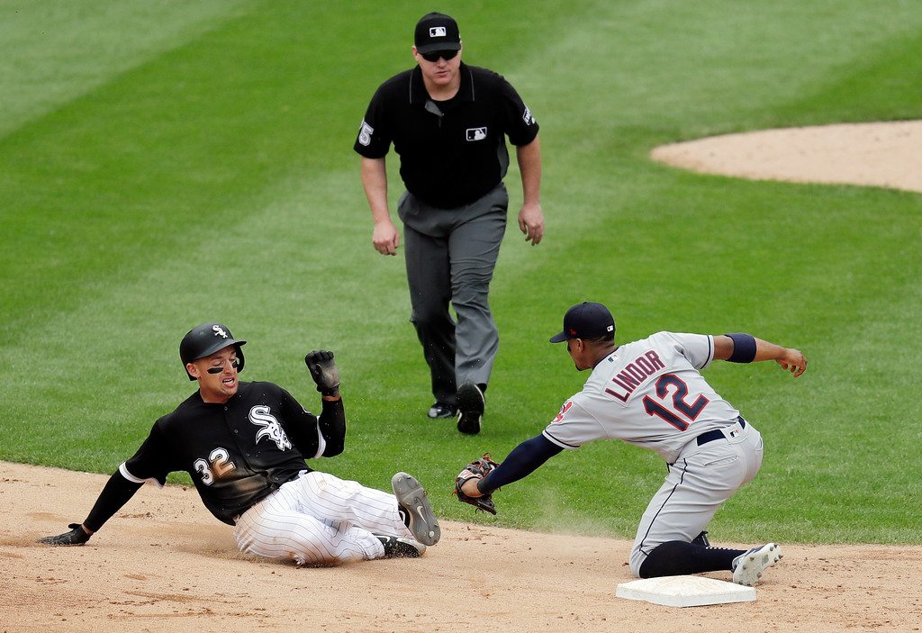 . Cleveland Indians shortstop Francisco Lindor, right, tags out Chicago White Sox\'s Trayce Thompson trying to steal second during the fifth inning of a baseball game Thursday, June 14, 2018, in Chicago. Umpire Tom Woodring watches the play. (AP Photo/Annie Rice)