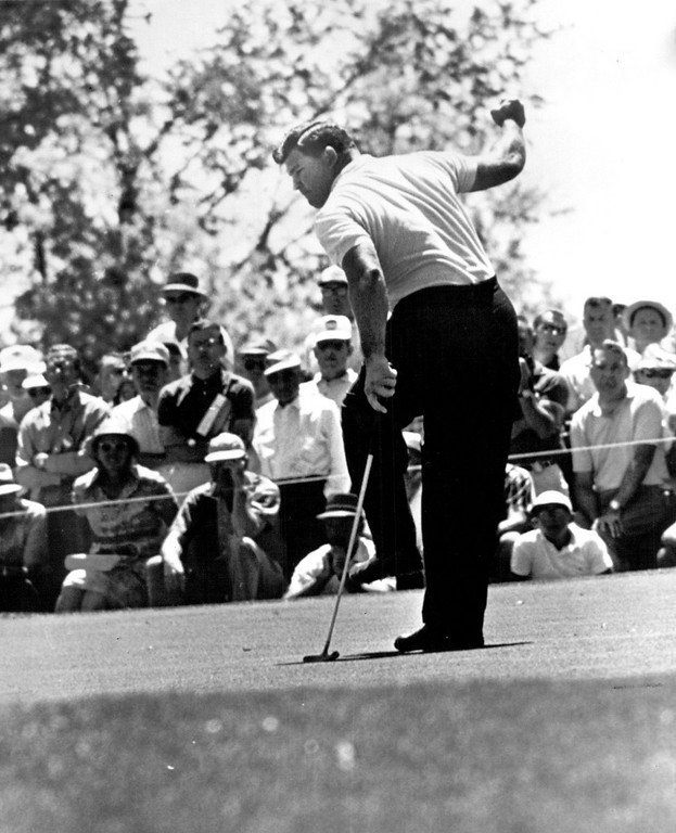 . Big Mike Souchak waves his fist and kicks his foot as a 22-foot putt goes into the cup for a birdie deuce on the sixth hole during the third round of the 1960 National Open at Cherry Hills. Souchak faded after early lead and lost Open to Arnold Palmer. Denver Post Library photo archive