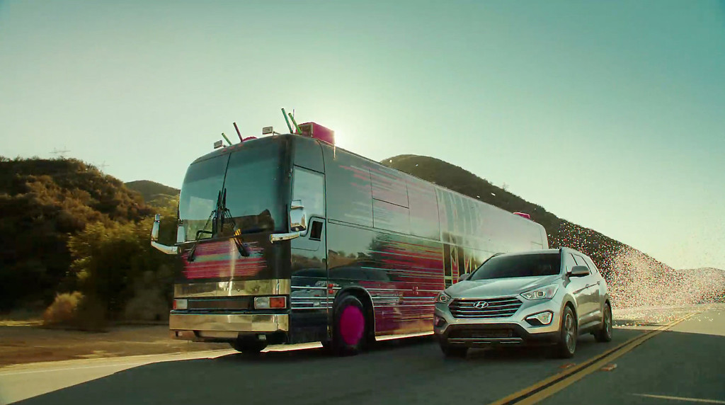""". This screen shot provided by Hyundai shows the Super Bowl advertisement by Hyundai Motor Group\'s Kia. In the advertisment, Kia invents a fanciful way that babies are made, blasting in from a baby planet in its \""""Space babies\"""" ad for the 2014 Sorento crossover. (AP Photo/Hyundai)"""