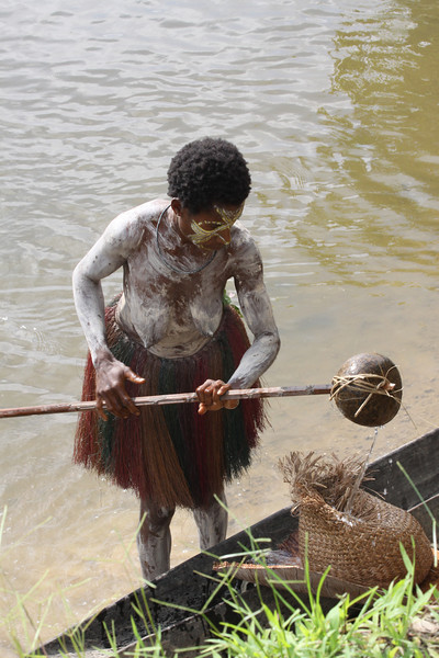 woman making flour from Sago palm tree