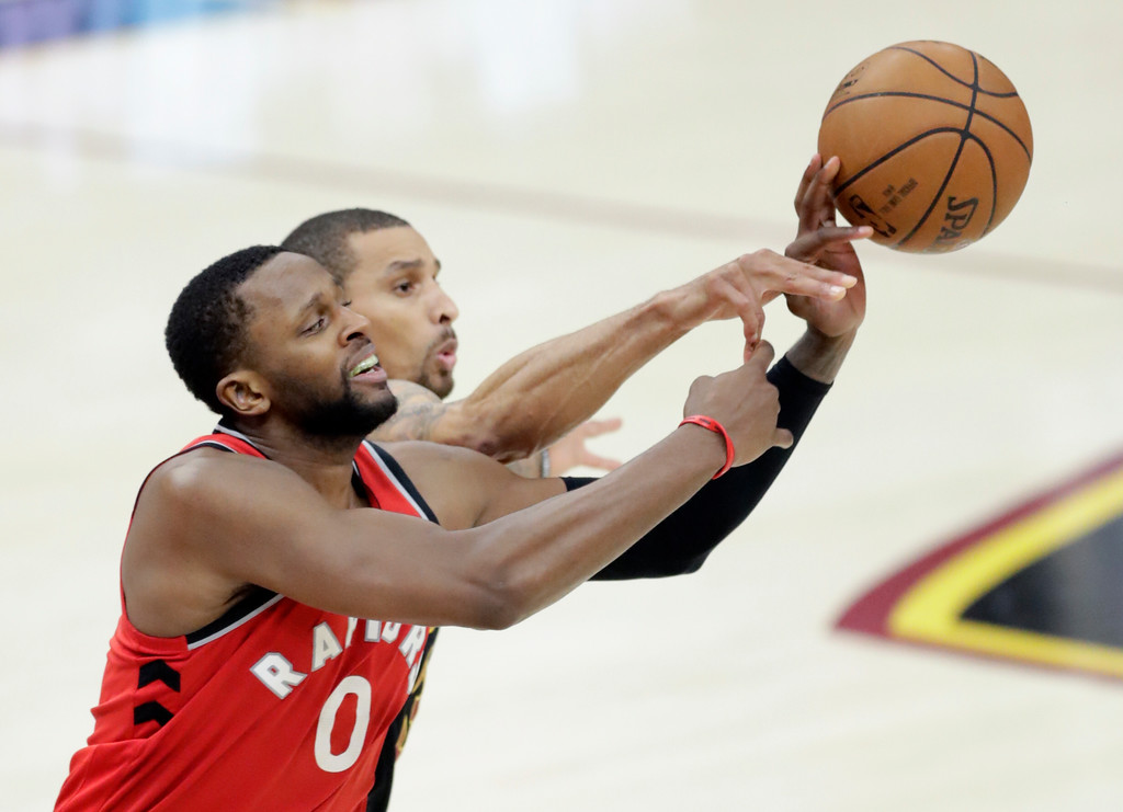 . Toronto Raptors\' CJ Miles (0) and Cleveland Cavaliers\' George Hill battle for the ball in the second half of Game 4 of an NBA basketball second-round playoff series, Monday, May 7, 2018, in Cleveland. (AP Photo/Tony Dejak)