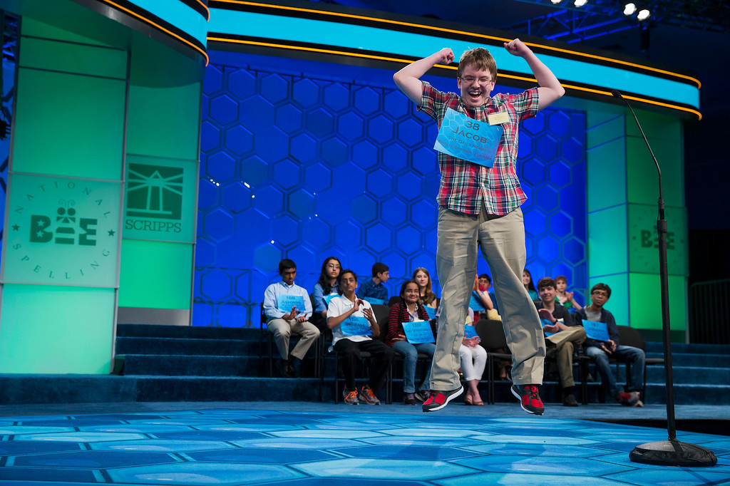 ". Eighth grade home-schooled student Jacob Williamson, 15, of Cape Coral, Fla., reacts after correctly spelling his word ""harlequinade\"", during the semifinals of the Scripps National Spelling Bee, Thursday, May 29, 2014, at National Harbor in Oxon Hill, Md. Williamson spelled his word correct. (AP Photo/ Evan Vucci)"