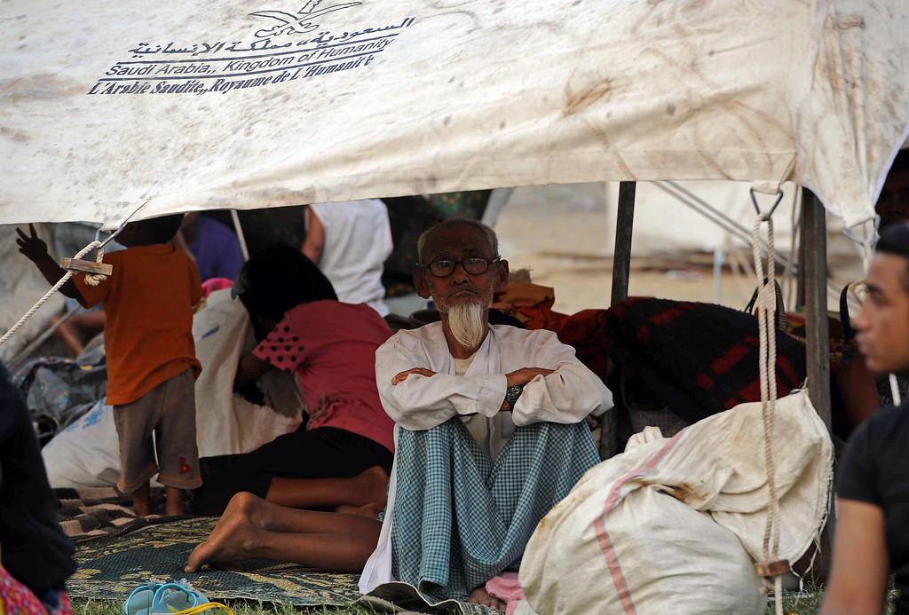 . Muslim residents rest under tents after they were evacuated to a temporary relief camp in riot-hit Meiktila, central Myanmar on March 22, 2013.   AFP PHOTO/ Soe Than WIN/AFP/Getty Images