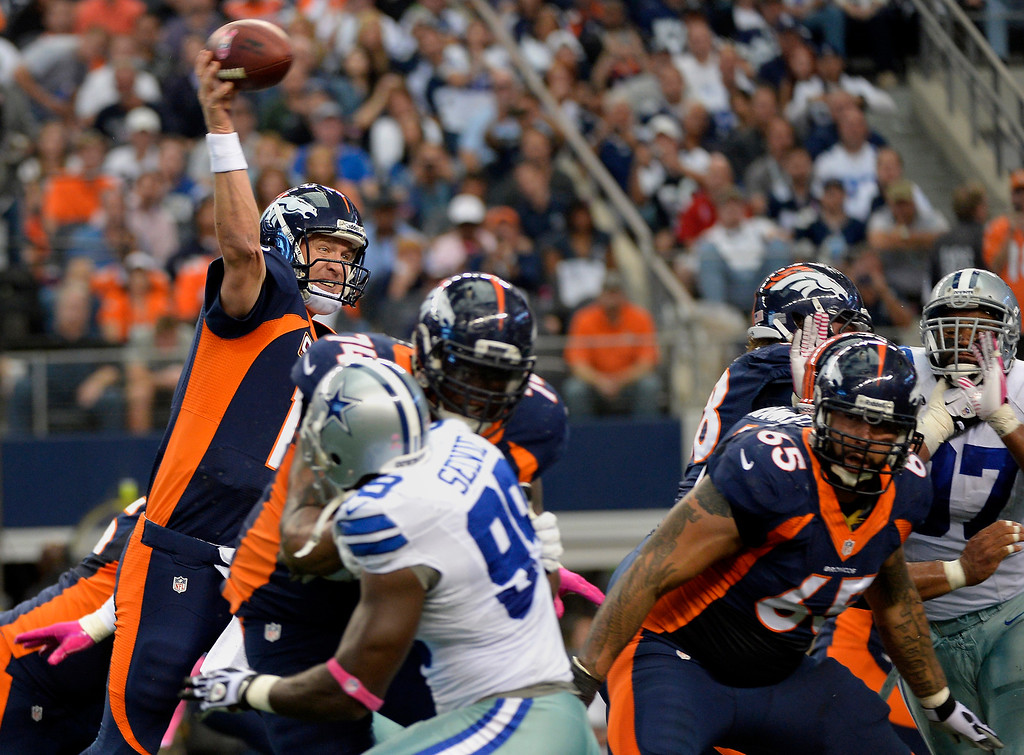 . Quarterback Peyton Manning #18 of the Denver Broncos hits tight end Julius Thomas #80 of the Denver Broncos to make the score 20-17 in the second quarter against the Dallas Cowboys in game 5 at AT&T Stadium October 06, 2013 Arlington, Texas. (Photo By Joe Amon/The Denver Post)