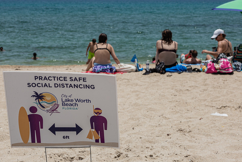 The City of Lake Worth Beach has placed signs on the beach to remind beachgoers to keep socially distant, Monday, June 29, 2020. Due to the rise in coronavirus cases, Palm Beach County will close beaches Friday, July 3 to help fight the spread of the disease. [JOSEPH FORZANO/palmbeachpost.com]