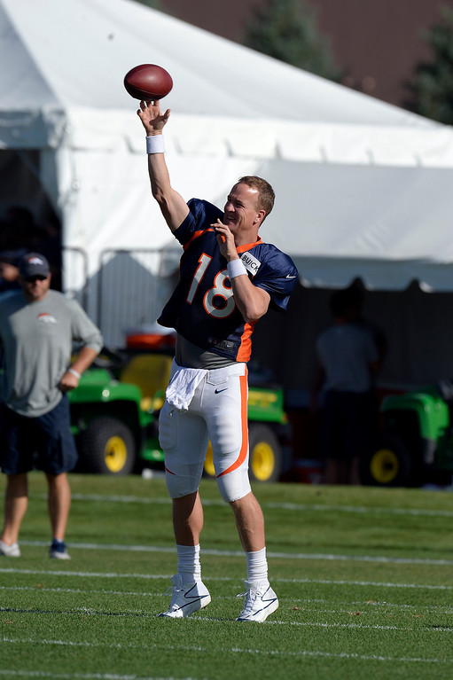 . Denver Broncos QB Peyton Manning (18) warms up during training camp August 6, 2013 at Dove Valley. (Photo By John Leyba/The Denver Post)