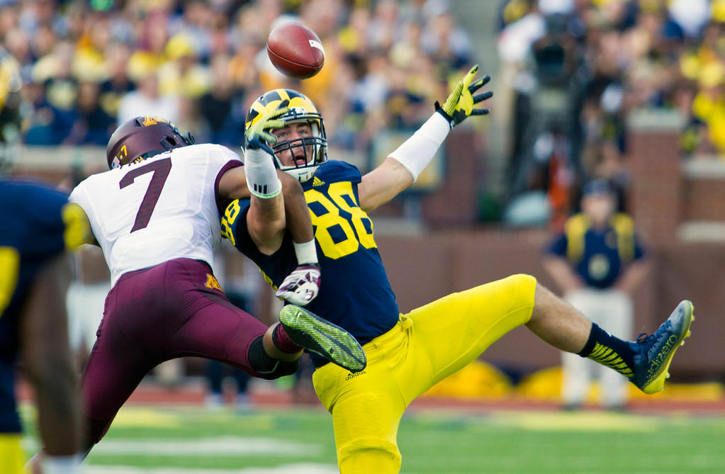 . Minnesota defensive back Damarius Travis (7) breaks up a pass intended for Michigan tight end Jake Butt (88) in the third quarter of an NCAA college football game in Ann Arbor, Mich., Saturday, Sept. 27, 2014. Minnesota won 30-14. (AP Photo/Tony Ding)