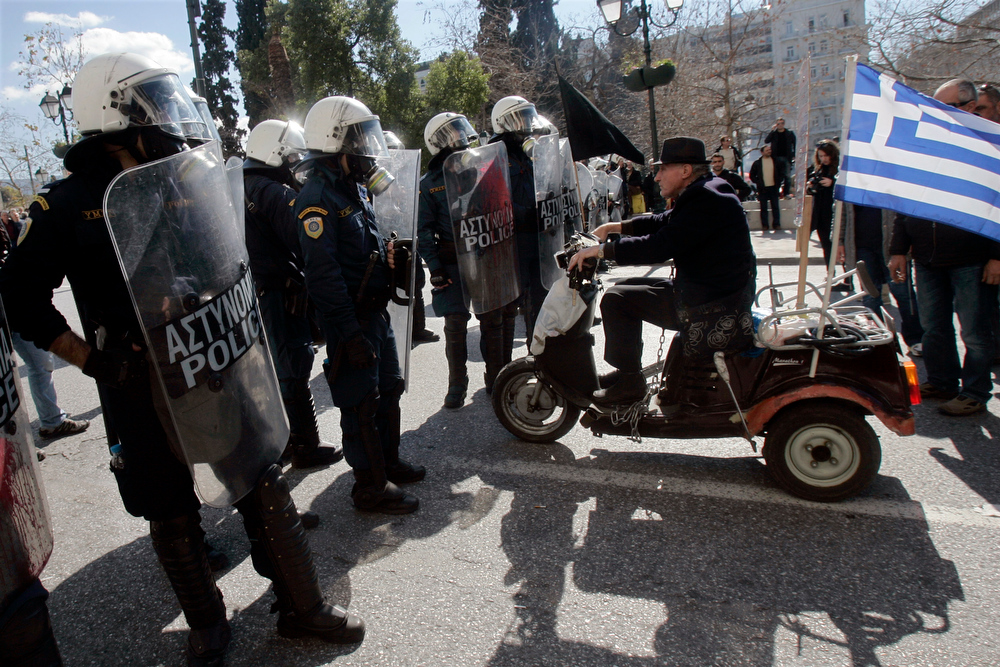. Riot police has blocked a street to prevent protestorsfrom gathering outside Greece\'s parliament during a protest on February 20, 2013 in Athens, Greece. Unions have launched  general strike against austerity measures in Greece, amid predictions unemployment in the crisis-hit country will reach 30 percent this year. (Photo by Milos Bicanski/Getty Images)